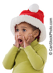 Surprised baby girl with red hat of Christmas on a over...