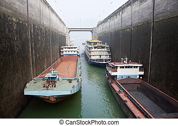 Ships rising in the lock at Three Gorges Dam, China