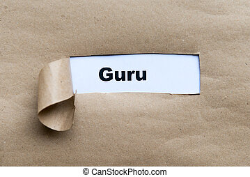 guru word on the torn paper background