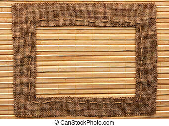 Frame of burlap, lies on a bamboo mat, with place for your...