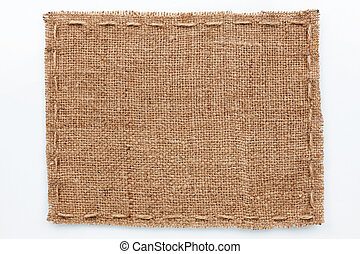 Frame of burlap lies on a white background, with place for...