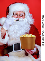in the cinema - Close-up portrait of Santa Claus eating...