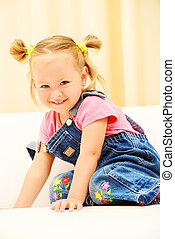 pediatrics - Pretty little girl playing at home. Happy...