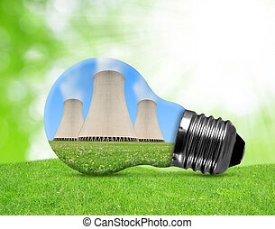 Nuclear power plant in bulb on green background