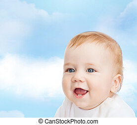smiling little baby - child and toddler concept - smiling...
