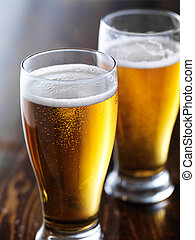 two mugs of beer close up