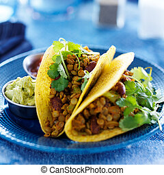 vegan lentil tacos with cilantro and guacamole on the side