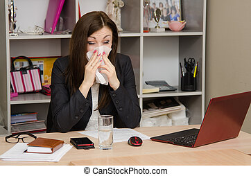 The girl wiping nose with a tissue in the office - Cute...