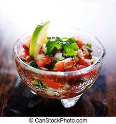pico de gallo salsa in glass molcajete