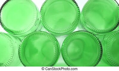 Green Bottle Bottoms Closeup Dolly - Close up dolly shot of...
