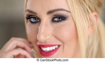 Smiling pretty blond with blue eyes - Smiling pretty blond...
