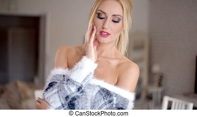 Glamorous gorgeous blond woman in a stylish off the shoulder...