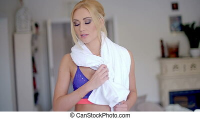Fit Woman Wiping her Sweat After Workout - Fit Blond Woman...