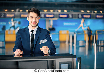 Handsome man in the airport - Business travel. Handsome...