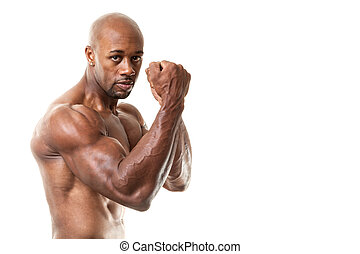 Muscular Man Fists Up - Ripped and muscular martial artist...