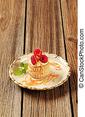 Custard filled puff pastry shell with raspberries