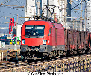 freight train - a freight train transporting goods by rail