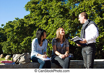 Three university students - Three students talking on a...