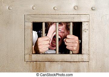 Going Insane - Man in prison going insane, grabbing the bars...
