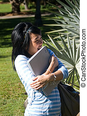Student holding notes