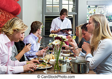 Taking orders - Waiter taking orders from a group of dinner...