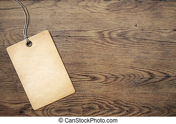 price tag on old wooden table background - price label or...