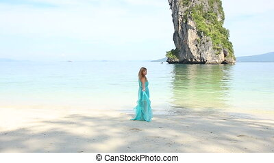 blonde girl stand on beach - asian blonde girl stands on...