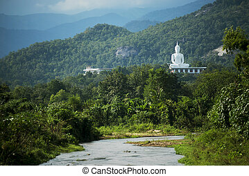 White buddha on the hill