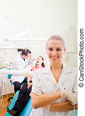 dentist assistant - a pretty blonde dentist assistant...