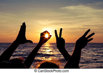 Love sign language at the sunset time