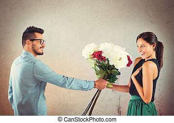 Girlfriend and boyfriend - Lover boy gives flowers to his...