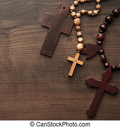 crosses over brown wooden background - three crosses on the...