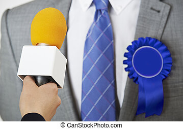 Politician Being Interviewed By Journalist During Election -...