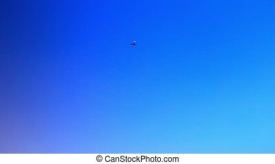 Airplane flying in a clear blue sky. Video - Airplane flying...