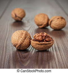 walnuts on the brown wooden table background