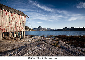 Norway Coast Boat House - A boat house on the coast of...