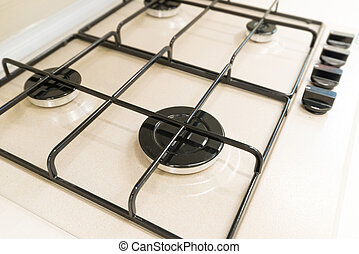 White gas stove with grill closeup - A White gas stove with...