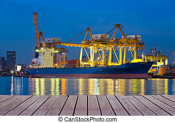 Cargo ship working with crane at port reflect on river,...