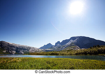 Lake Mountain Norway - A lake landscape with moutain in...