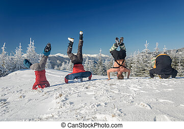Group of skiers standing on his head on mountain - Group of...