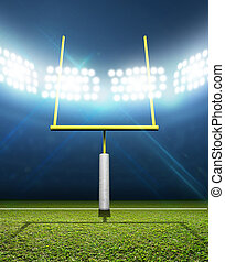 Football Stadium Night - A football stadium with posts on a...