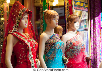 Indian Mannequins - Three mannequins dressed in colourful,...