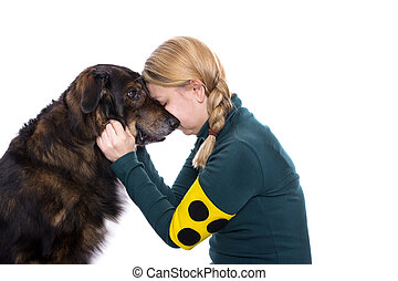 Guide dog - A blind woman is touching her guide dog and...