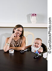Mother with baby sitting in high chair