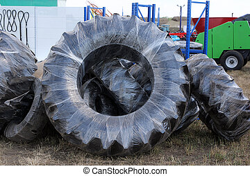 wheels of tractors tire and farm equipment in the package.