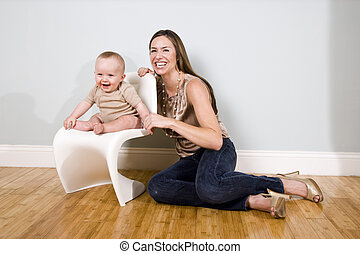 Mother with six month old baby at home