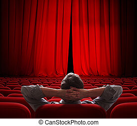 cinema screen red curtains slightly open for vip person -...