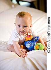 Cute baby playing with a toy - Cute six month old baby...