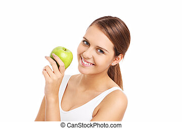 Pretty woman holding green apple - A picture of a happy...