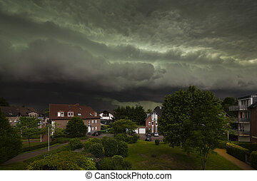 Approaching Thunderstorm Over Residential District -...
